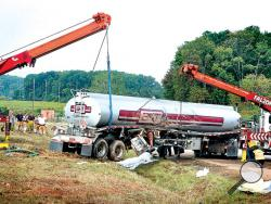 Two cranes set a tanker truck back on its wheels during cleanup of an accident in the westbound lanes of Interstate 80 just east of the Lightstreet interchange on Tuesday morning. (Press Enterprise/Bill Hughes)