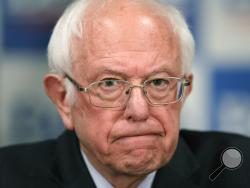 FILE - In this March 12, 2020, file photo Democratic presidential candidate, Sen. Bernie Sanders, I-Vt., speaks to reporters about coronavirus in Burlington, Vt. (AP Photo/Charles Krupa, File)