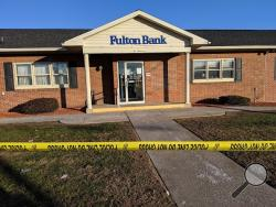 Police tape is stretched in front of Fulton Bank at 200 S. Poplar St., Berwick, after a report of a bank robbery. (Press Enterprise/Jimmy May)