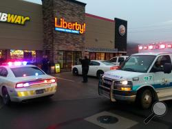 Police and ambulance crews gather at the Liberty Travel Plaza after a robbery was reported in the plaza's parking lot. (Press Enterprise/Jimmy May)