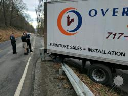 A furniture delivery truck is hung up on a guardrail near the entrance to Wonderview on Thursday afternoon. (Press Enterprise/Jimmy May)