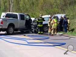 Rescue crews work to free occupants of two pickups that crashed on Route 11 on Tuesday. (Press Enterprise/Jimmy May)