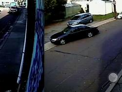 A composite of two images provided by Bower Security shows the dark-colored car believed to be involved in a Nov. 1 pedestrian hit-and-run.
