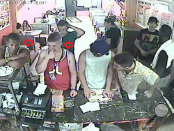 Police are looking for more information on the two men identified by red arrows, who are seen in surveillance video taking money from the register at Frank's Pizzeria on Main Street. (Special to the Press Enterprise/Bower Media)