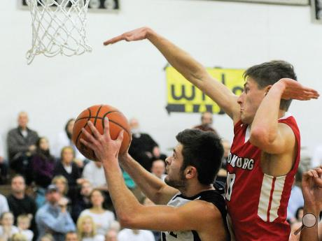 Bloomsburg's Tristan Wright, right, gets over Central Columbia's Kevin Krause while trying to block the first-quarter shot during Friday night's game at Central.