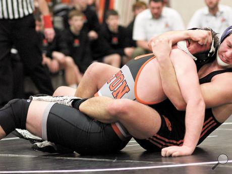 Benton's Marcus Welliver, right, cradles Milton's Nevin Aeppli in the 220-pound match during the District Four Duals on Saturday afternoon at Milton High School.
