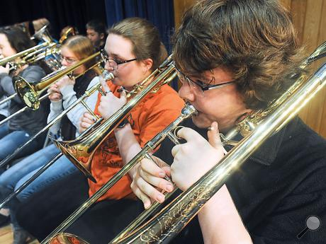 Millville trombonist David Earnest plays with the horn section at the Columbia County Band rehearsal Thursday morning. The County Band concert will be held tonight at 7:00 p.m at Central Columbia.
