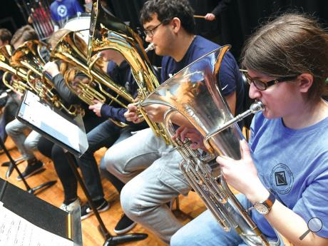 Central Columbia's Laura Deroba, right, sits with her fellow brass players during rehearsal Thursday for the Columbia County Band Festival at Southern Columbia. This year's concert will be held tonight at 7 in the Southern Columbia High School Auditorium.