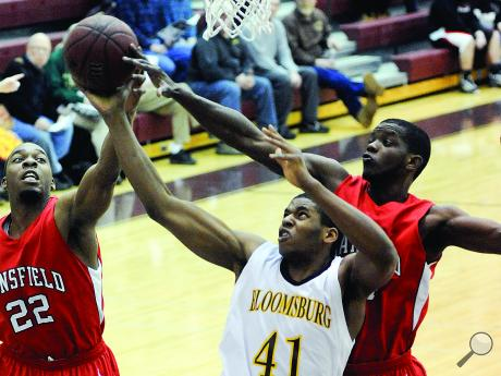 Onyema utti and joe bell knock the ball out of bounds as bloomsburg