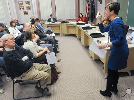 Kim Keck, owner of Exclusively You at West Main and Market streets in Bloomsburg, addresses Town Council and the crowd gathered at Monday evening's council meeting about how proposed changes in parking meter enforcement hours will affect her clients.