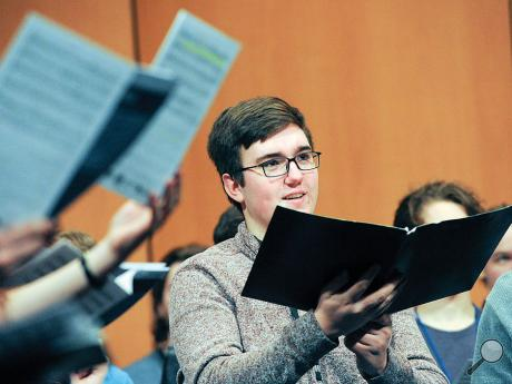 Bloomsburg High School's Timothy Kirk watches the director while singing during Thursday morning rehearsal for the PMEA Region IV Chorus at the Community Arts Center inWilliamsport. The chorus will perform at the center at 7 p.m. tonight