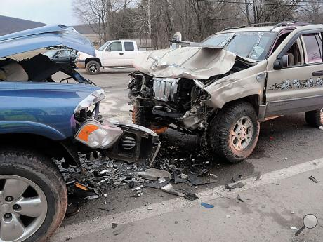 One woman was taken to the hospital following a head-on collision between a pick-up truck and Jeep that happened on Route 11, between the former Bear Chrysler and Big B Ice Cream Shop on Monday afternoon