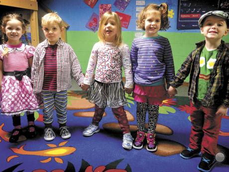 Trinity Child Care preschool students, from left, Elise Prall, Noah Esworthy, Caitlin Nevel, Harper Bowman and Wesley Flickner display their Wacky Wednesday clothing choices at the Trinity United Methodist Church in Mahoning Township on Wednesday morning.