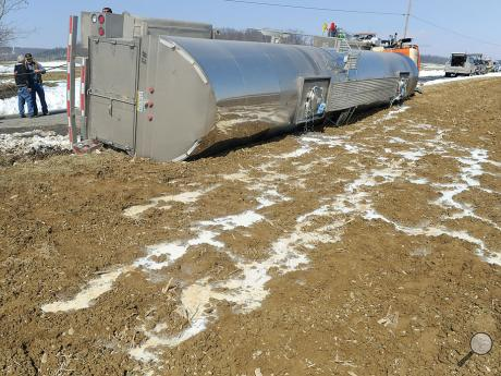 Milk leaks from the top hatches ofa tractor trailer tanker after it overturned along Betz Road in Anthony Township Tuesday afternoon.