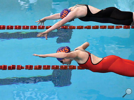 Danville's Brenna Ross, top, and teammate Caroline Spahr leave the starting blocks during the second heat of the 50 freestyle during Thursday evening's District Swimming Championships at the Williamsport High School.