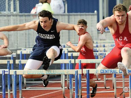 Central Columbia's Levi Bartholomew, left and Mount Carmel's Christian Kelley run neck and neck as they cross the last hurdle in the 110-meter hurdles during Tuesday afternoon's meet at Central.Central Columbia's Levi Bartholomew, left and Mount Carmel's Christian Kelley run neck and neck as they cross the last hurdle in the 110-meter hurdles during Tuesday afternoon's meet at Central.