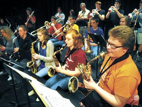 Mount Carmel musician Luke Darrup,  at right, players his baritone sax with the Pennsylvania Music Educators Association District 8 Jazz Ensemble during rehearsal in Danville on Friday.