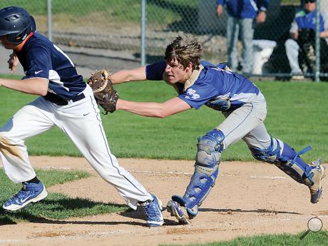 Warrior Run's catcher Michael Muffy, right, chases down Central Columbia's Evan Williams for the out as Williams tried to score on a single by Dominic Coombe in the fourth inning of Wednesday afternoon's game at Central.