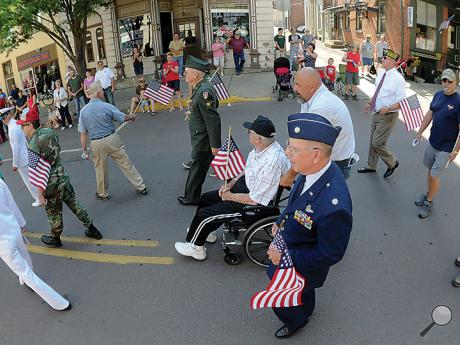 A group of veterans head down Mill Street in Danville while walking in the annual Memorial Day parade Monday morning.