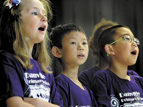 Members of the Danville Primary School Music Makers, from left, Lily O'Rourke, Charles Zhao and Andrew Li sing a medley of patriotic songs during the Memorial Day program on Thursday.