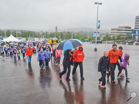 Nearly one thousand participants walk at the start of the Susquehanna Valley March of Dimes, March for Babies, on Sunday morning in the parking lot of Geisinger Medical Center in Danville.