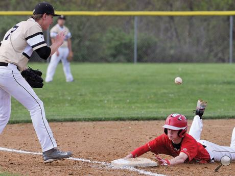 Bloomsburg's Matt Lee gets into third base safely as Southern Columbia's Tyler Tomaschik waits for the throw after a double by Joe Zola in the fifth inning of Monday afternoon's game at Southern.