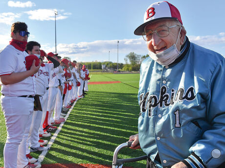Bloomsburg's former baseball coach John F. Babb stands on the field which has been named after as the team takes to the third base line before the start of Wednesday evening's game against Warrior Run.