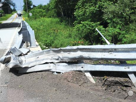 Truck Takes Out Guardrail