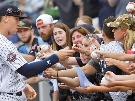 New York Yankee Aaron Judge, playing for the Scranton/Wilkes-Barre Railriders on a rehab assignment,signs a few autographs before the start of Tuesday night's game at PNC Field in Moosic against the Norfolk Tide.
