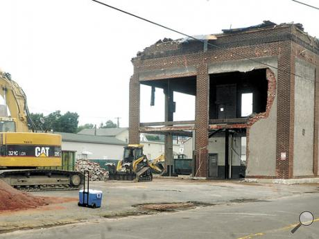 A crew from Enviro-Air Technologies, of Coopersburg, demolishes the UGI building between West Seventh Street and the North Shore Railroad tracks in Bloomsburg on Tuesday. The building was formerly a coal-gas plant.