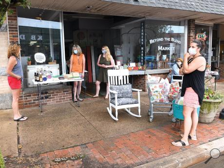 Vendors from Beyond the Blend Market in Berwick, from left, Suzanne Chapel, Teri Watson, Nikki Sunday, Rachel Lipski and Monica Zourides sell their wares outside the cooperative on Front Street Wednesday afternoon. It will close at the end of July.