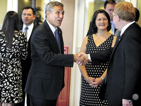 U.S. Rep. Lou Barletta (R-Hazleton), left, shakes hands with Bloomsburg University President David Soltz as the Congressman arrives at Monty's on the upper campus for a Columbia Montour Chamber of Commerce breakfast on Thursday.