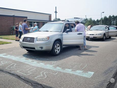 "Cars line up at the starting line of the ""Amazing Grace"" road rally scavenger hunt event at Good Shepherd Lutheran Church in Berwick on Sunday afternoon."