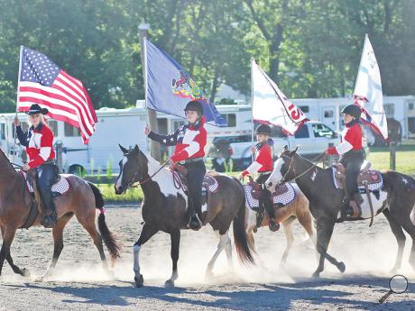 "Riders from Rocky Road Stables in Bloomsburg ride into the corral to the tune of ""Made in America"" by Toby Keith during during the 5th Annual Bobby George Show, at the Susquehanna Valley Corral in Danville, in honor of Bobby George's 95th birthday."