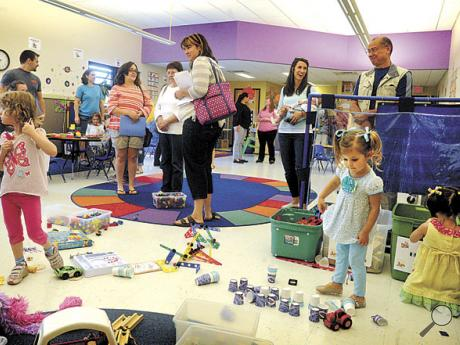 Parents and children take a look around the preschool room in the Danville Child Development Center's Bloom Road location on Thursday morning.