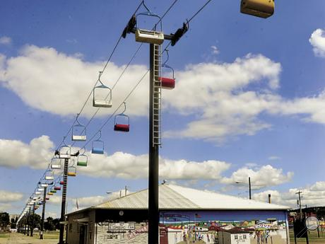 Reithoffers' workers have installed the seats on the Sky Ride cables in preparation for the 161st Bloomsburg Fair, September 23 to October 1. Fair officials say the Sky Ride is set up early to insure time for the ride's annual inspection.