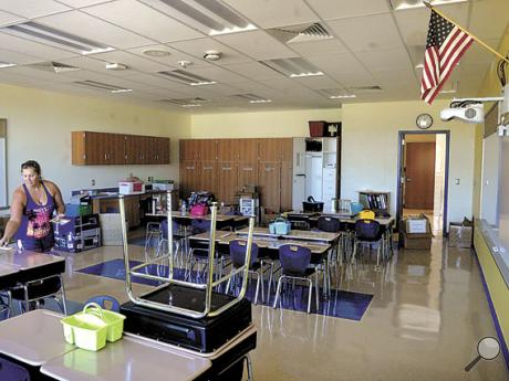 West Berwick Elementary School fourth grade teacher Susan Eisenhauer sets up her classroom in the new school on Tuesday. She moved from the Orange Street Elementary School. Classes are scheduled to begin in the new school on Tuesday, September 6.