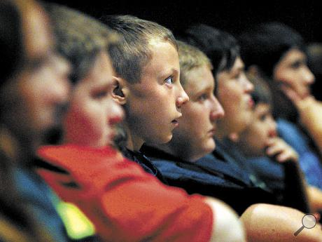 Berwick Middle School students watch a video on the 1999 school shootings at Columbine during the Rachel's Challenge program at Berwick High School on Thursday.