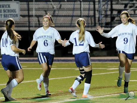 Berwick girls soccer players, from left, Olivia Seely, Gabby Kishbaugh, Olivia Conkin and Paige Superko celebrate after scoring the first goal in Wednesday night's game against Honesdale at Crispin Field.