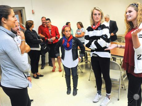 Women's World Cup Soccer MVP, Carli Lloyd, left, talks with Millville High School National Honor Society members, from left: Brooke Kremer, Morgan Bower and Hayley Reichner prior to an assembly at the school Monday afternoon.