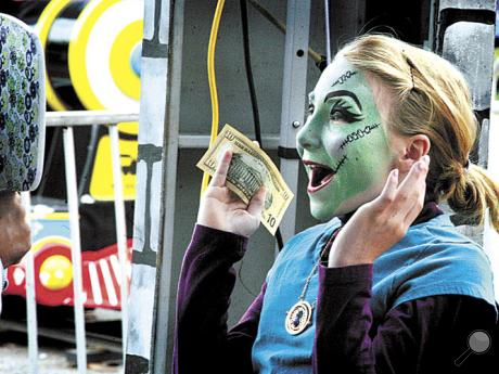 Lily Jones, 10, of Bloomsburg, shows her delight with her face painting when shown her face in a mirror at the Bloomsburg Fair on Friday. Tina Serneels, Tampa, Fla, , did the work.