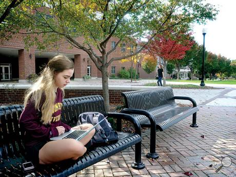 Bloomsburg University freshman Katy Highlands, Mechanicsburg, sits on a bench in the academic quad on a nearly deserted campus during the third day of the APSCUF strike on Friday. She said she was trying to stay ahead of her class work.