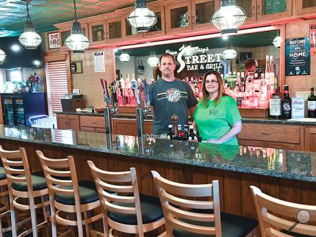 Brian Brutosky and Missy Peters standbehind the bar at their restaurant, Brian and Missy's Main Street Bar & Grill, in Mocanaqua onMonday afternoon. The restaurant will reopen Wednesday after being shut down by a fire in January of this year.