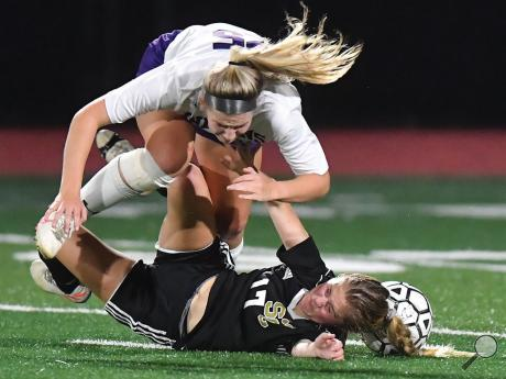Southern Columbia's Evelyn Cook, bottom, and Shamokin's Madyson Waugh go to the turf after getting tangled up while trying to win the ball during the first half of Wednesday night's game at Southern.