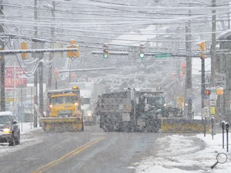 One plow truck heads north up 239, right, as a second continues north on Route 11 Wednesday afternoon as they clear snow in Shickshinny.