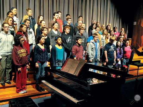 Music teacher Tara Smargiassi, right, leads the Central Columbia High School chorus in rehearsal in the school auditorium on Thursday morning. The chorus and the band, directed by Kevin Haile, will perform in the school's annual Holiday Concert tonight in the high school auditorium. Doors open at 6:35 p.m. and the concert begins at 7.