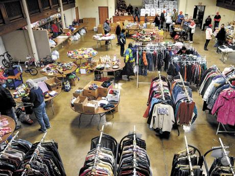 Registered recipient families choose from a large selection of clothing, toys and food in the Danville Borough Hall Ballroom during the annual Danville Community Christmas Tree giveaway on Friday. This year over 320 families were served. Leftover clothing and toys will be available to all from 9 a.m. to noon on Saturday, Dec. 27.