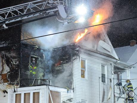 Flames break through the top of the roof at this apartment building at 711 Pine Street in Berwick early Thursday morning.
