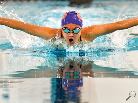 Danville's Joy Zhang swims her first butterfly lap while swimming in the 200IM during Tuesday afternoon's meet against Central Mountain at Danville.