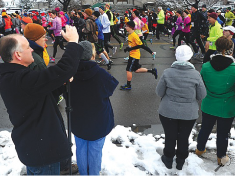 Spectators cheer on runners and snap some photos at the annual Run for the Diamonds in Berwick Thursday.